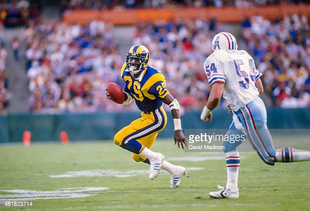 Eric Dickerson of the Los Angeles Rams runs for yardage during a National Football League game against the Houston Oilers played on December 17 1984...