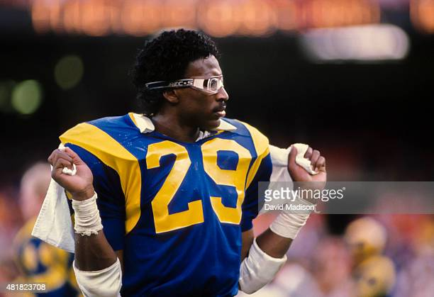Eric Dickerson of the Los Angeles Rams waits on the sidelines a National Football League game against the Houston Oilers played on December 17 1984...