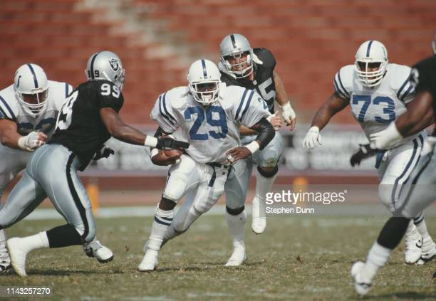 Eric Dickerson Running Back for the Indianapolis Colts runs the ball against the Los Angeles Raiders during their National Football Conference West...
