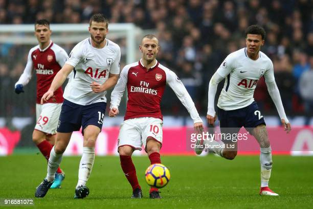Eric Dier and Dele Alli both of Tottenham Hotspur and Jack Wilshere of Arsenal in action during the Premier League match between Tottenham Hotspur...