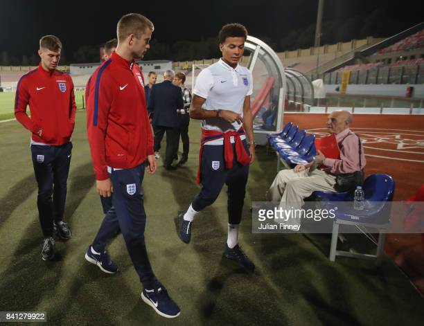 Eric Dier and Dele Alli of England in discussion as they inspect the pitch on the eve of the World Cup qualifying match against Malta at Ta'Qali...