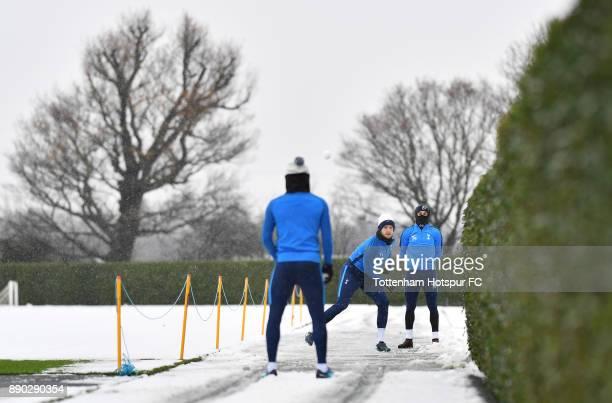 Eric Dier and Harry Winks of Tottenham Hotspur throw snowballs at Kieran Trippier of Tottenham Hotspur during a Tottenham Hotspur Training Session on...