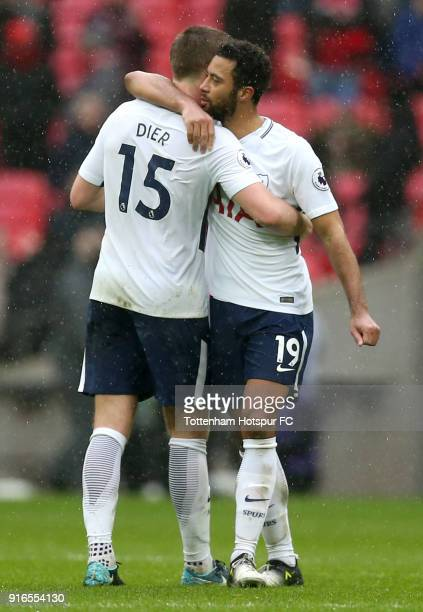Eric Dier and Mousa Dembele of Tottenham Hotspur embrace following the Premier League match between Tottenham Hotspur and Arsenal at Wembley Stadium...