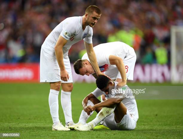 Eric Dier and Phil Jones of England console teammate Marcus Rashford of England after England's defeat in the 2018 FIFA World Cup Russia Semi Final...