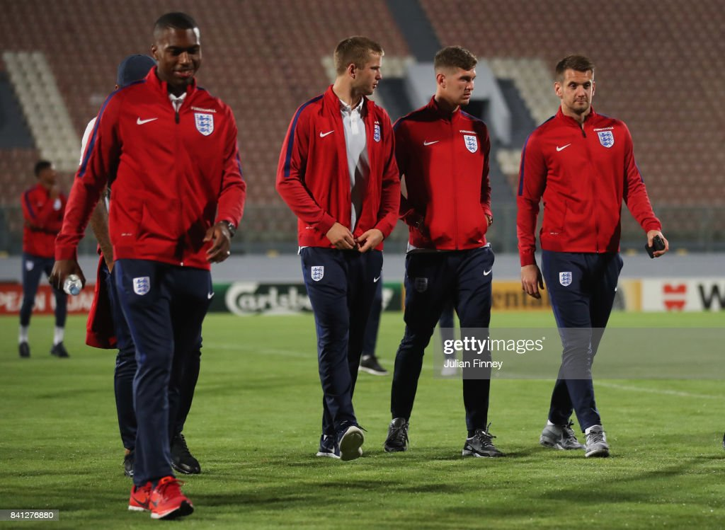 Eric Dier, John Stones and Tom Heaton of England in discussion as they inspect the pitch on the eve of the World Cup qualifying match against Malta at Ta'Qali National Stadium on August 31, 2017 in Valletta, Malta.