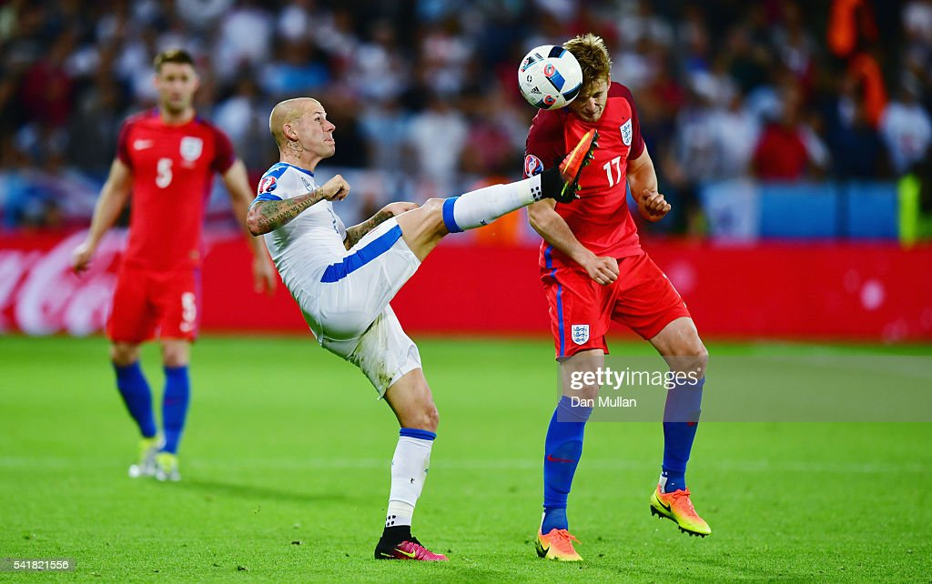 Eric Dier of England and Vladimir Weiss of Slovakia compete for the ball during the UEFA EURO 2016 Group B match between Slovakia and England at Stade Geoffroy-Guichard on June 20, 2016 in Saint-Etienne, France.