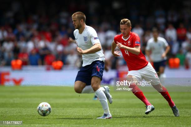 Eric Dier of England battles for possession with Nico Elvedi of Switzerland during the UEFA Nations League Third Place Playoff match between...
