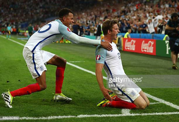 Eric Dier of England celebrates scoring his team's first goal with his team mate Dele Alli during the UEFA EURO 2016 Group B match between England...