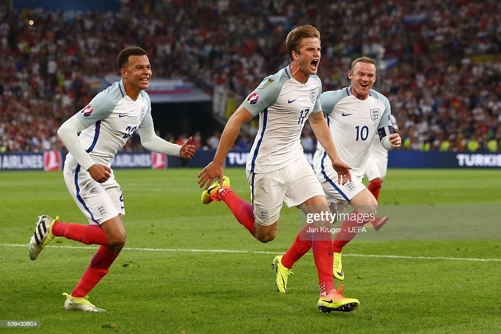 Eric Dier (C) of England celebrates scoring his team's first goal with his team mates Dele Alli (20) and Wayne Rooney (10) during the UEFA EURO 2016 Group B match between England and Russia at Stade Velodrome on June 11, 2016 in Marseille, France.