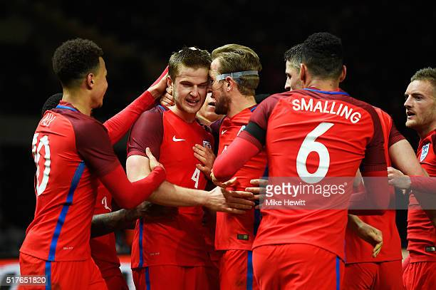 Eric Dier of England celebrates scoring his team's third goal with his team mates during the International Friendly match between Germany and England...
