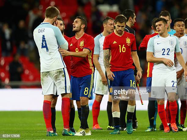 Eric Dier of England clashes with Dani Carvajal and Koke of Spain after the international friendly match between England and Spain at Wembley Stadium...