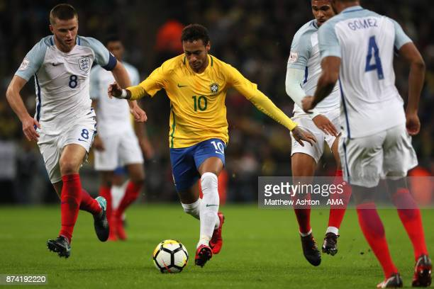 Eric Dier of England competes with Neymar of Brazil during the international friendly match between England and Brazil at Wembley Stadium on November...