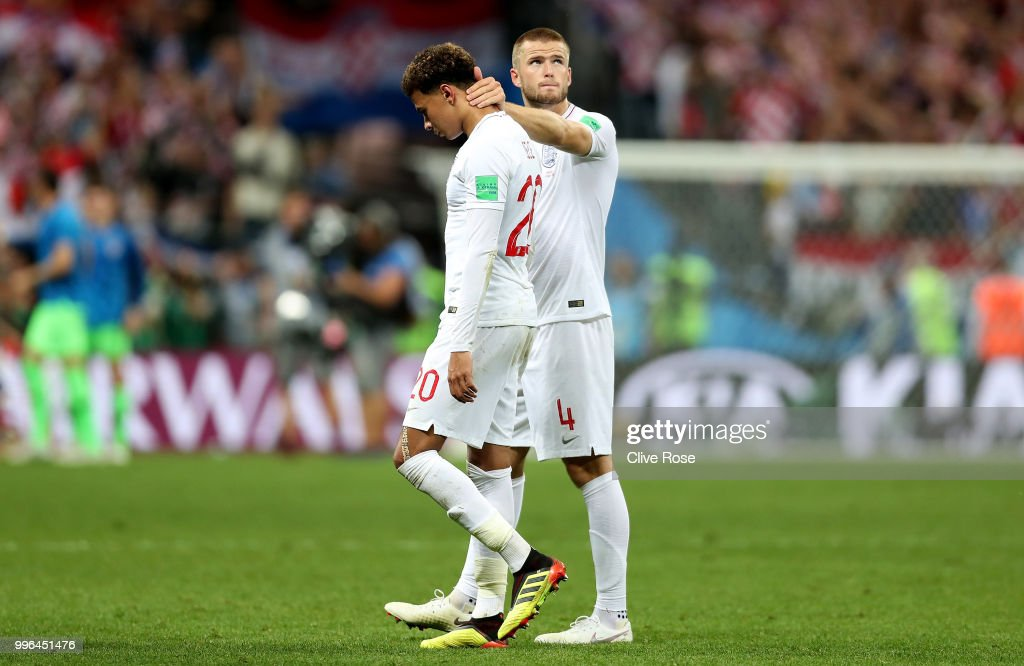 Eric Dier of England consoles team mate Dele Alli of England following their team's defeat in the 2018 FIFA World Cup Russia Semi Final match between England and Croatia at Luzhniki Stadium on July 11, 2018 in Moscow, Russia.