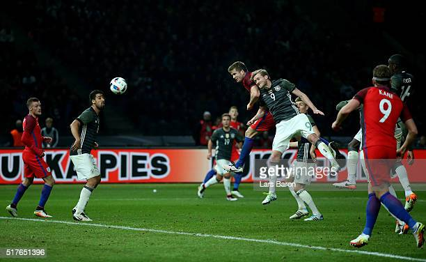 Eric Dier of England heads his teams third goal during the International Friendly match between Germany and England at Olympiastadion on March 26...