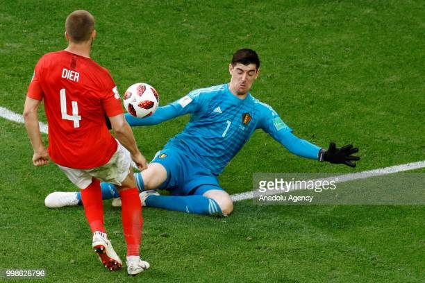 Eric Dier of England in action againstThibaut Courtois of Belgium during the 2018 FIFA World Cup RussiaPlayOff for Third Place between Belgium and...