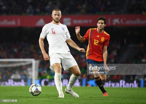 Eric Dier of England is watched by Marcos Alonso of Spain during the UEFA Nations League A Group Four match between Spain and England at Estadio...