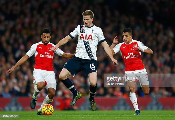 Eric Dier of Spurs battles for the ball with Francis Coquelin of Arsenal and Alexis Sanchez of Arsenal during the Barclays Premier League match...