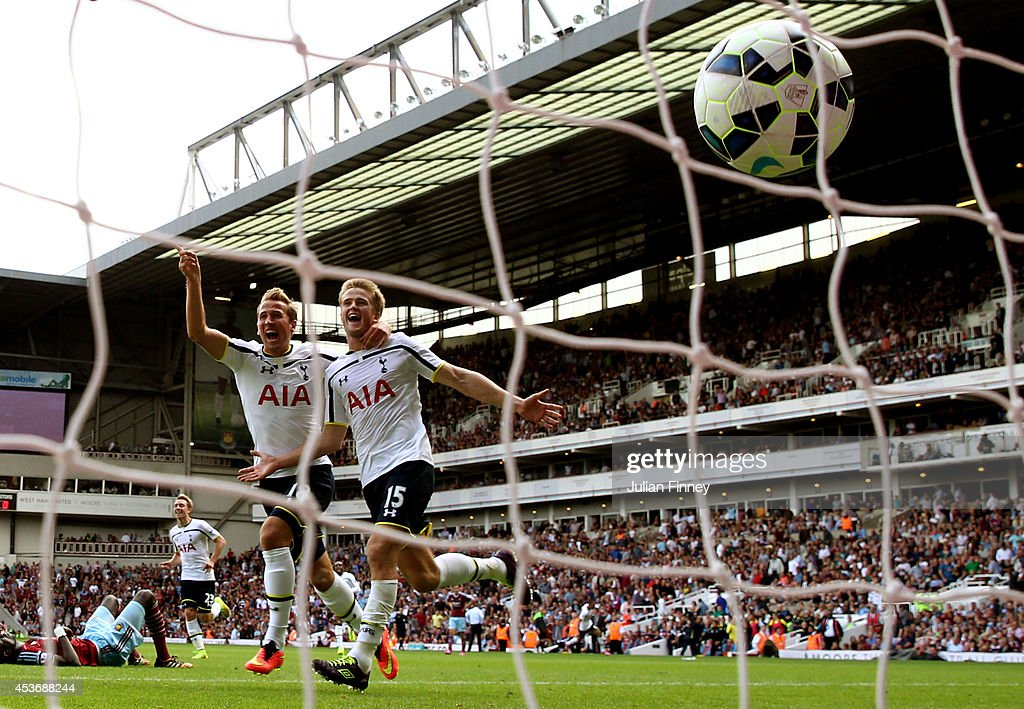 Eric Dier #15 of Spurs celebrates with teammate Harry Kane #18 after scoring the match winning goal during the Barclays Premier League match between West Ham United and Tottenham Hotspur at Boleyn Ground on August 16, 2014 in London, England.