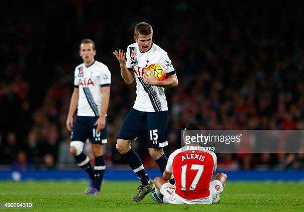 Eric Dier of Spurs gestures to Alexis Sanchez of Arsenal during the Barclays Premier League match between Arsenal and Tottenham Hotspur at the...