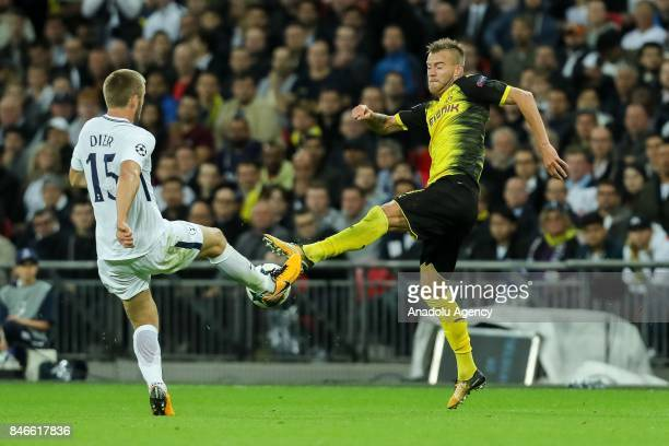 Eric Dier of Tottenham and Andrey Yarmolenko of Dortmund battle for the ball during the UEFA Champions League group H match between Tottenham Hotspur...