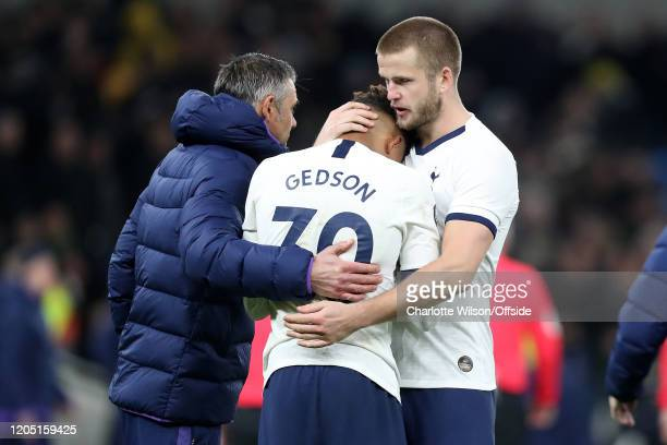 Eric Dier of Tottenham consoles Gedson Fernandes after they lose on penalties during the FA Cup Fifth Round match between Tottenham Hotspur and...