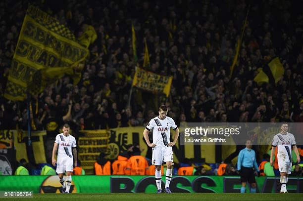 Eric Dier of Tottenham Hotspur alongside team mates reacts as PierreEmerick Aubameyang of Borussia Dortmund scores their second goal during the UEFA...
