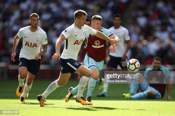 Eric Dier of Tottenham Hotspur and Johann Guomundsson of Burnley battle for possession during the Premier League match between Tottenham Hotspur and...