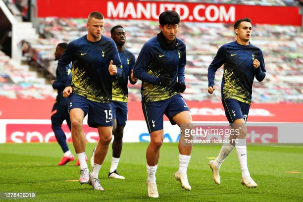 Eric Dier of Tottenham Hotspur and Son HeungMin of Tottenham Hotspur warm up ahead of the Premier League match between Manchester United and...