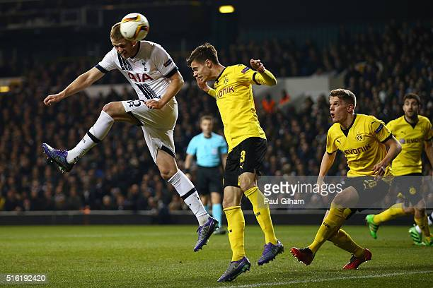 Eric Dier of Tottenham Hotspur beats Julian Weigl of Borussia Dortmund to the ball during the UEFA Europa League round of 16 second leg match between...