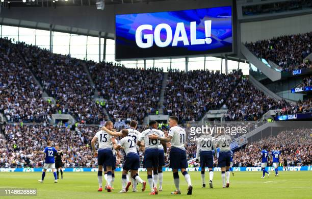 Eric Dier of Tottenham Hotspur celebrates with teammates after scoring his team's first goal during the Premier League match between Tottenham...
