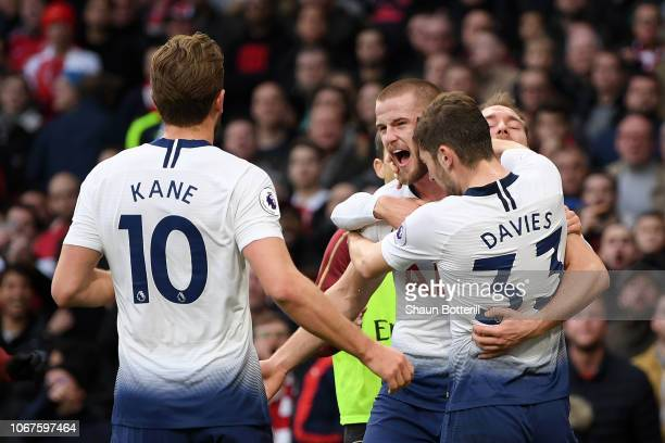 Eric Dier of Tottenham Hotspur celebrates with teammates Ben Davies Harry Kane and Christian Eriksen after scoring his team's first goal during the...