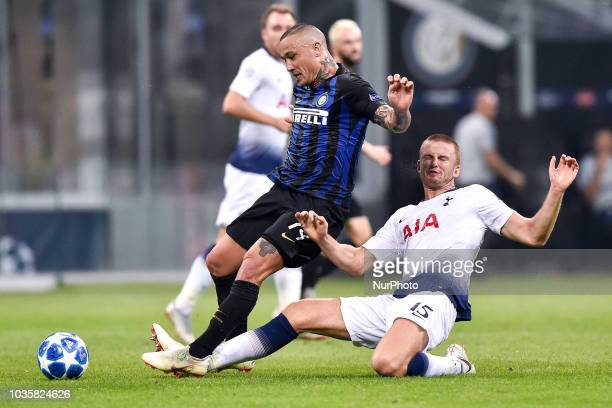 Eric Dier of Tottenham Hotspur challenges Radja Nainggolan of Inter Milan during the UEFA Champions League Group B match between Inter Milan and...