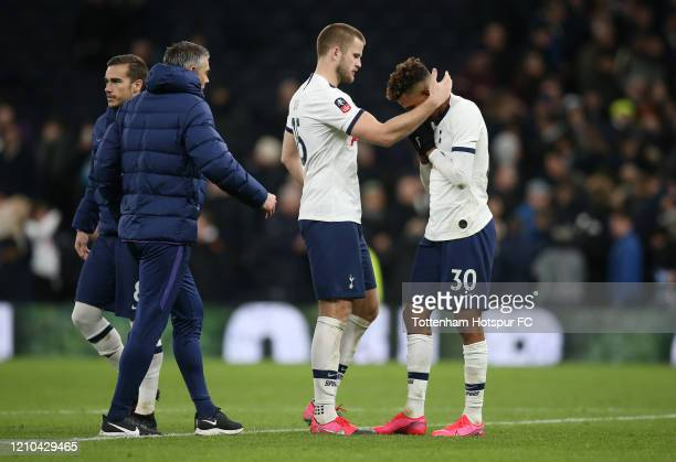 Eric Dier of Tottenham Hotspur consoles Gedson Fernandes of Tottenham Hotspur after he misses a penalty in the penalty shootout during the FA Cup...