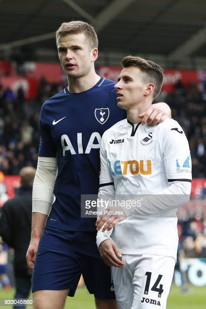 Eric Dier of Tottenham Hotspur consoles Tom Carroll of Swansea after the final whistle of the Fly Emirates FA Cup Quarter Final match between Swansea...