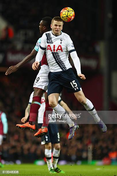 Eric Dier of Tottenham Hotspur Emmanuel Emenike of West Ham United battle for a header during the Barclays Premier League match between West Ham...