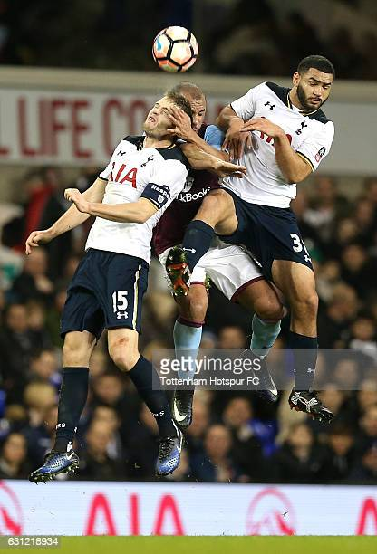 Eric Dier of Tottenham Hotspur , Gabriel Agbonlahor of Aston Villa and Cameron Carter-Vickers of Tottenham Hotspur battle to win a header during The...