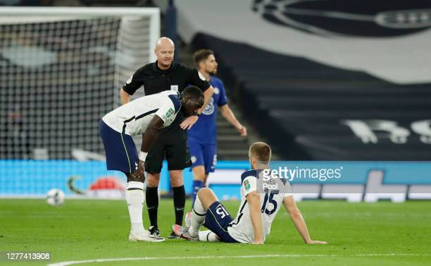 Eric Dier of Tottenham Hotspur goes down injured during the Carabao Cup fourth round match between Tottenham Hotspur and Chelsea at Tottenham Hotspur...