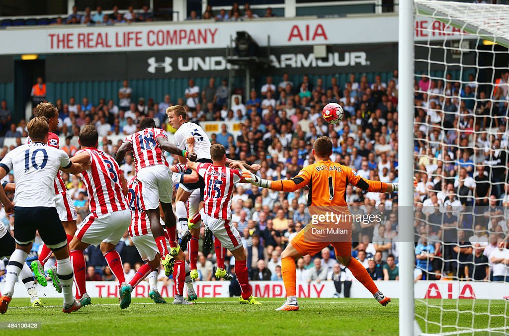 Eric Dier of Tottenham Hotspur heads the ball to scores his team's first goKelvin Davis of Southampton during the Barclays Premier League match between Tottenham Hotspur and Stoke City at White Hart Lane on August 15, 2015 in London, United Kingdom.