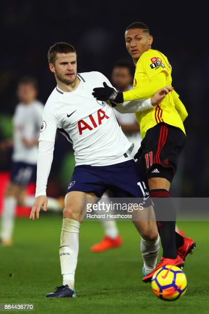 Eric Dier of Tottenham Hotspur is challenged by Richarlison de Andrade of Watford during the Premier League match between Watford and Tottenham...