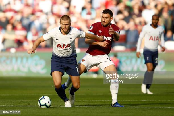 Eric Dier of Tottenham Hotspur is challenged by Robert Snodgrass of West Ham United during the Premier League match between West Ham United and...