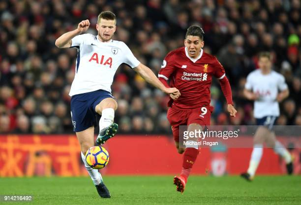 Eric Dier of Tottenham Hotspur is challenged by Roberto Firmino of Liverpool during the Premier League match between Liverpool and Tottenham Hotspur...