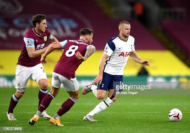 Eric Dier of Tottenham Hotspur is closed down by Chris Wood and Josh Brownhill of Burnley during the Premier League match between Burnley and...