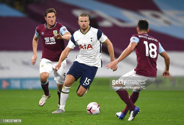 Eric Dier of Tottenham Hotspur is closed down by Chris Wood and Ashley Westwood of Burnley during the Premier League match between Burnley and...