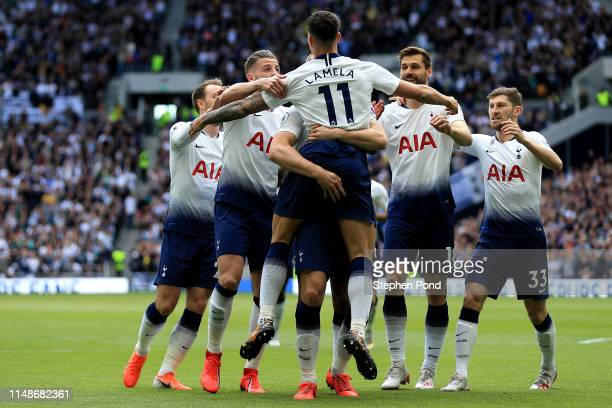 Eric Dier of Tottenham Hotspur is mobbed as he celebrates after scoring his team's first goal during the Premier League match between Tottenham...