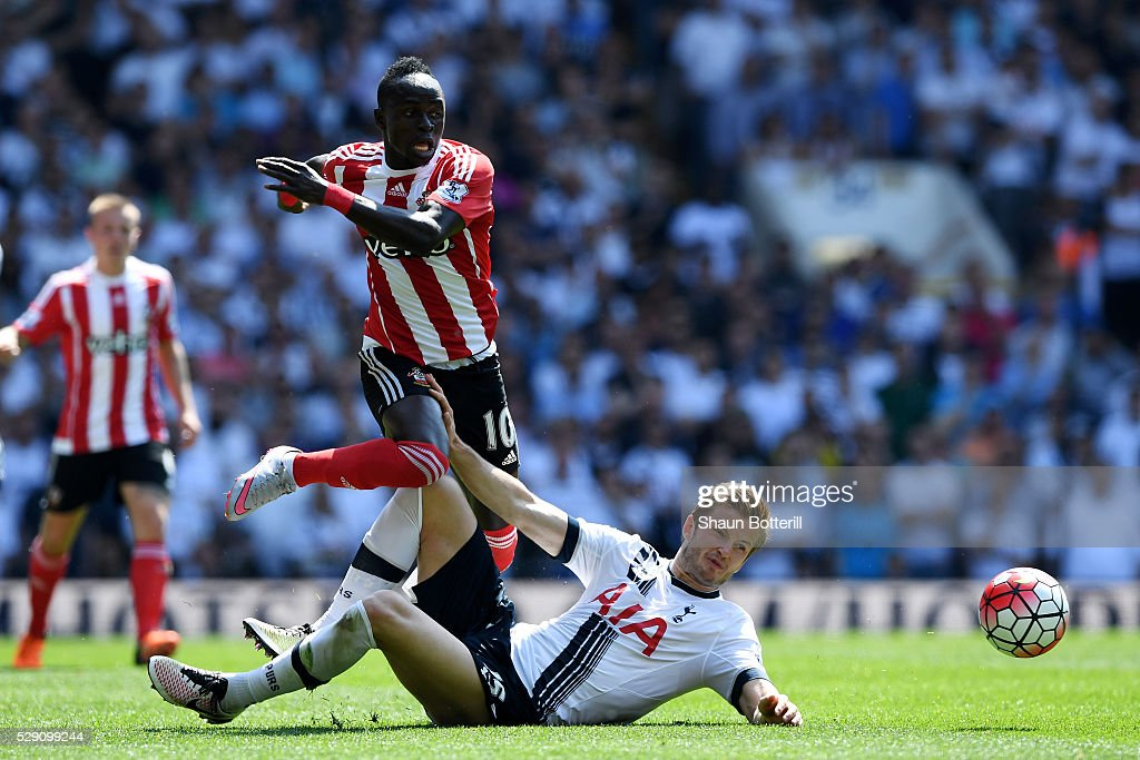 Eric Dier of Tottenham Hotspur makes a challenge on Sadio Mane of Southampton during the Barclays Premier League match between Tottenham Hotspur and Southampton at White Hart Lane on May 8, 2016 in London, England.