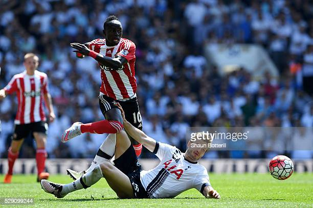 Eric Dier of Tottenham Hotspur makes a challenge on Sadio Mane of Southampton during the Barclays Premier League match between Tottenham Hotspur and...