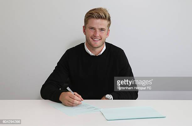 Eric Dier of Tottenham Hotspur poses while signing a new contract on September 6 2016 in Enfield England