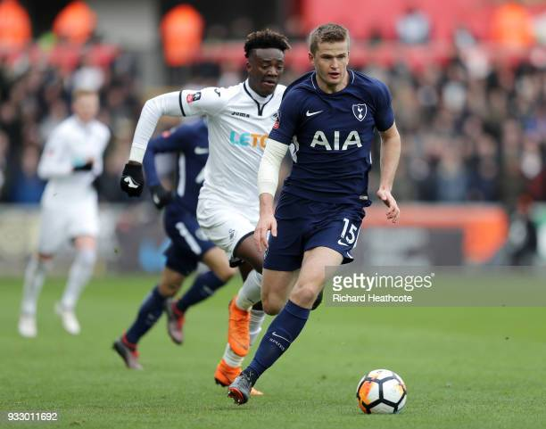Eric Dier of Tottenham Hotspur runs with the ball under pressure from Tammy Abraham of Swansea City during The Emirates FA Cup Quarter Final match...