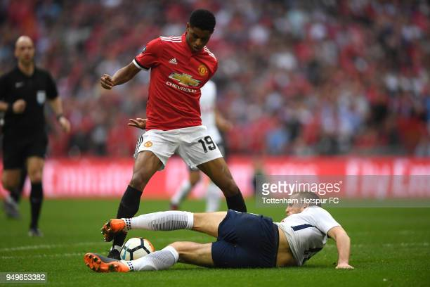 Eric Dier of Tottenham Hotspur tackles Marcus Rashford of Manchester United during The Emirates FA Cup Semi Final match between Manchester United and...