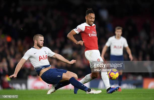 Eric Dier of Tottenham Hotspur tackles PierreEmerick Aubameyang of Arsenal during the Premier League match between Arsenal FC and Tottenham Hotspur...